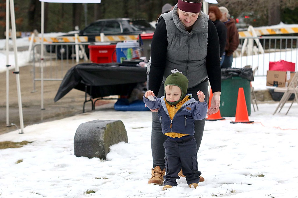 . Enjoying nice walk in the swnow at the Fitchburg Winterfest at Coggshall Park is Logan Roy, 1, and his mom Michelle Roy of Fitchburg. SENTINEL & ENTERPRISE/JOHN LOVE