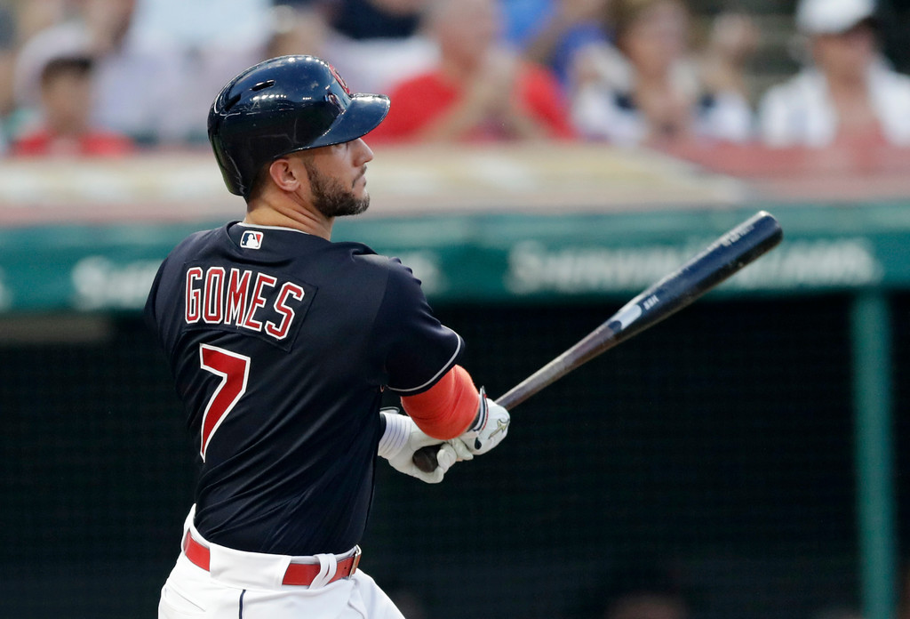 . Cleveland Indians\' Yan Gomes hits an one-run double off Tampa Bay Rays starting pitcher Blake Snell in the second inning of a baseball game, Saturday, Sept. 1, 2018, in Cleveland. (AP Photo/Tony Dejak)
