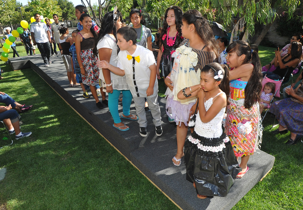 """. Students line the runway after showing their wearable art in the \""""Art of Recycling\"""" showcase at the Community Resource Center in South Whittier on Thursday June 20, 2013. Students from the CRC�s Homework Assistance Program will join other local artists to showcase their wearable art made from 100% recyclable items such as newspaper, plastics, can tabs, candy wrappers, and other materials that most people toss in the trash. (SGVN/Staff Photo by Keith Durflinger)"""