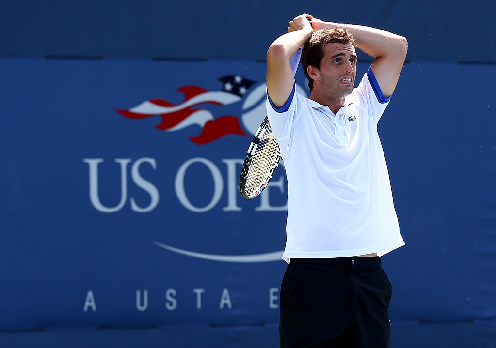 . NEW YORK, NY - AUGUST 26:  Albert Ramos of Spain reacts next to his partner Fabio Fognini of Italy during their men\'s doubles first round match against John-Patrick Smith of Australia and Paul Hanley of Australia on Day One of the 2013 US Open at USTA Billie Jean King National Tennis Center on August 26, 2013 in the Flushing neighborhood of the Queens borough of New York City.  (Photo by Alex Trautwig/Getty Images)