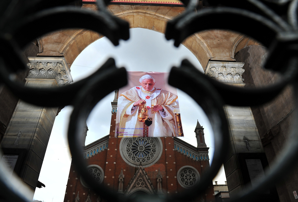 ". A poster showing Pope Benedict XVI portrait is hanged  in front of St. Anthony of Padua Church reading ""Thank you holy father\"" on February 27, 2013 in Istanbul.  Pope Benedict XVI will hold the last audience of his pontificate in St Peter\'s Square on Wednesday on the eve of his historic resignation as leader of the world\'s 1.2 billion Catholics.  BULENT KILIC/AFP/Getty Images"