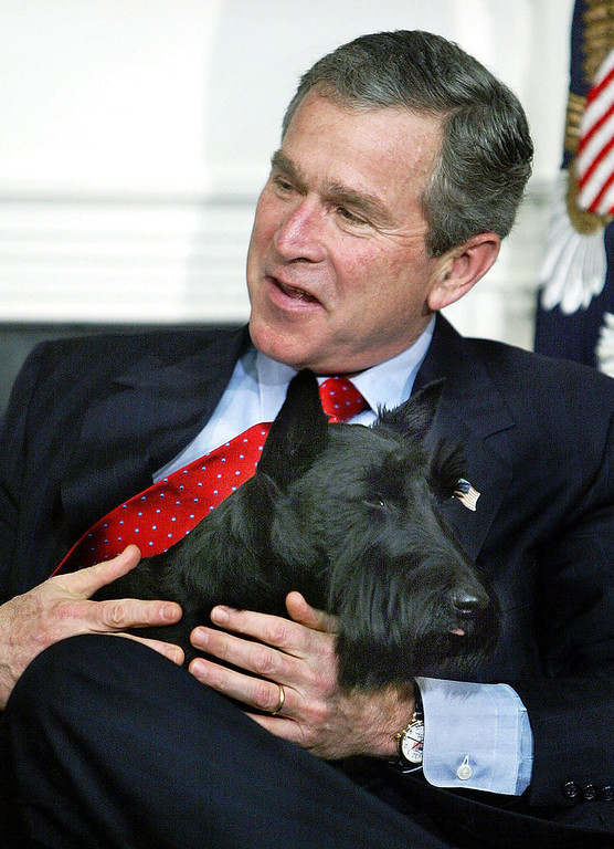 . President Bush holds his dog Barney after it came into the room and frightened area children as Bush participated in the White House children\'s story hour, Tuesday, Dec. 17, 2002, in the Roosevelt Room of the White House in Washington. (AP Photo/Ron Edmonds)