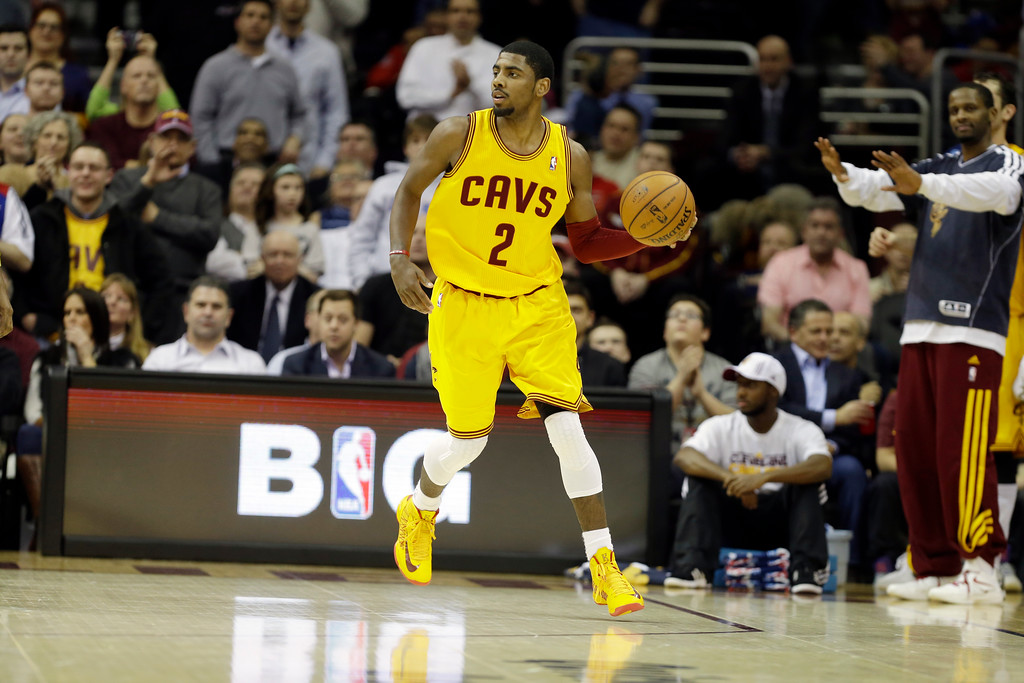 . Cleveland Cavaliers\' Kyrie Irving brings the ball up against the New Orleans Hornets in an NBA basketball game Wednesday, Feb. 20, 2013, in Cleveland. (AP Photo/Mark Duncan)
