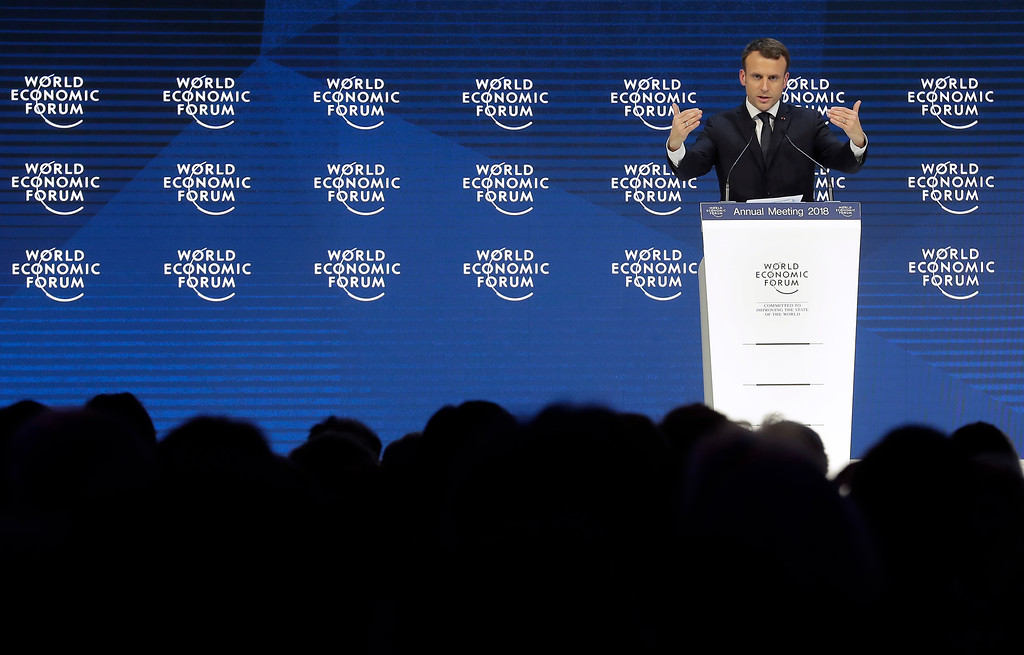 . Emmanuel Macron, President of France, gestures during a special address as part of the annual meeting of the World Economic Forum in Davos, Switzerland, Wednesday, Jan. 24, 2018. (AP Photo/Markus Schreiber)