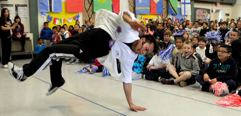 ". R J Navalta, of Fremont, performs a break dancing move at El Monte Elementary School as part of a ""Science Rocks\"" program in Concord, Calif., on Tuesday, Feb. 26, 2013.  (Susan Tripp Pollard/Staff)"