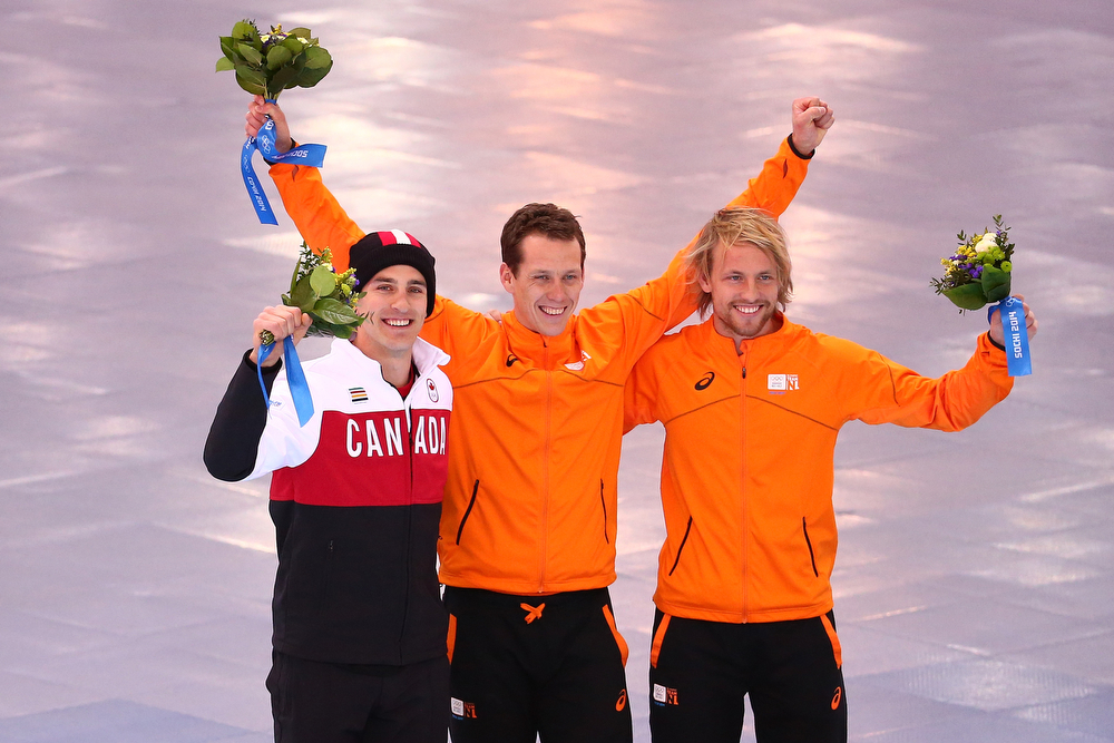 . (L-R) Silver medalist Denny Morrison of Canada, gold medalist Stefan Groothuis of the Netherlands and bronze medalist Michel Mulder of the Netherlands celebrate during the flower ceremony for the  Men\'s 1000m Speed Skating event during day 5 of the Sochi 2014 Winter Olympics at at Adler Arena Skating Center on February 12, 2014 in Sochi, Russia.  (Photo by Streeter Lecka/Getty Images)