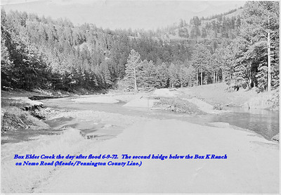 Box Elder Creek the day after the flood of 6/9/72.  The second bridge below the Box K Ranch on Nemo Road (Meade/Pennington County Line).