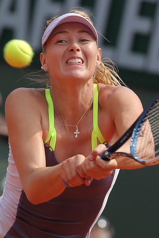 . Russia\'s Maria Sharapova returns against Serena Williams of the U.S. in the women\'s final of the French Open tennis tournament, at Roland Garros stadium in Paris, Saturday June 8, 2013. (AP Photo/Michel Euler)