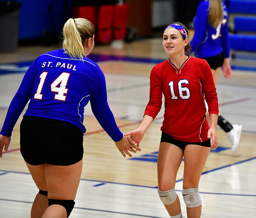 10/11/2019 Mike Orazzi | StaffrSt. Paul's Megan Fortier (14) and Grace Carabetta (16) during Thursday nights girls volleyball with Torrington in Bristol. r