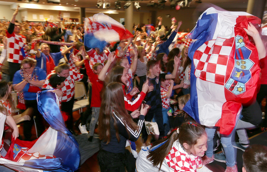 . Croatia fans at the King Tom Club in Sydney, Australia, celebrate Croatia\'s first goal the soccer World Cup final against France, Monday, July 16, 2018. (AP Photo/Rick Rycroft)