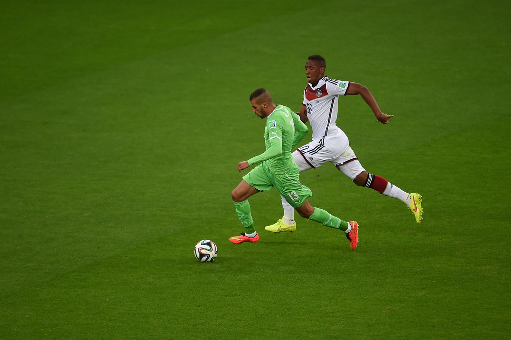 . Algeria\'s forward Islam Slimani (L) and Germany\'s defender Jerome Boateng vie during the Round of 16 football match between Germany and Algeria at Beira-Rio Stadium in Porto Alegre during the 2014 FIFA World Cup on June 30, 2014.   CHRISTOPHE SIMON/AFP/Getty Images