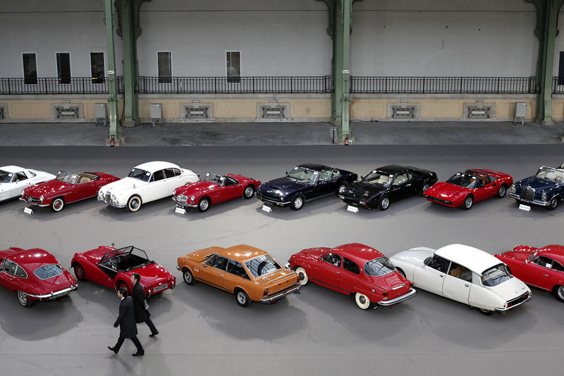 . Visitors walk past vintage and classic cars displayed by Bonhams auction house, during an exhibition, at the Grand Palais in Paris, Wednesday, Feb. 5, 2014. The Grand Palais is staging an exhibition of vintage cars, to be followed by a sale of historic cars by Bonhams auction house on Thursday. (AP Photo/Thibault Camus)