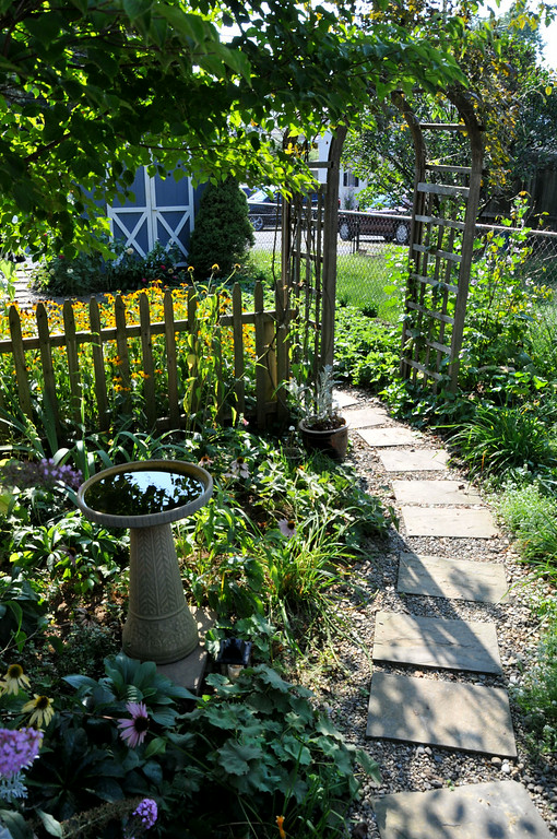 . PHOTO PETE BANNAN- Follow the path intoTerry Spadoni\'s West Chester row home garden.