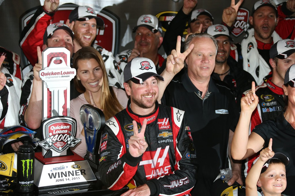 . Kurt Busch celebrates in the winner\'s circle after the NASCAR Sprint Cup series auto race at Michigan International Speedway, Sunday, June 14, 2015, in Brooklyn, Mich. (AP Photo/Bob Brodbeck)