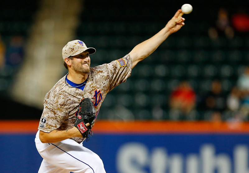 . Jonathon Niese #49 of the New York Mets pitches in the first inning against the Colorado Rockies at Citi Field on September 8, 2014 in the Flushing neighborhood of the Queens borough of New York City.  (Photo by Jim McIsaac/Getty Images)