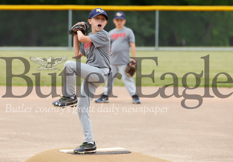 Cam Kleba winds up to pitch in the Mars Diamondbacks game against the Red Sox in Wednesday night's matchup of the  9-10 year old Mars little league. Seb Foltz/Butler Eagle