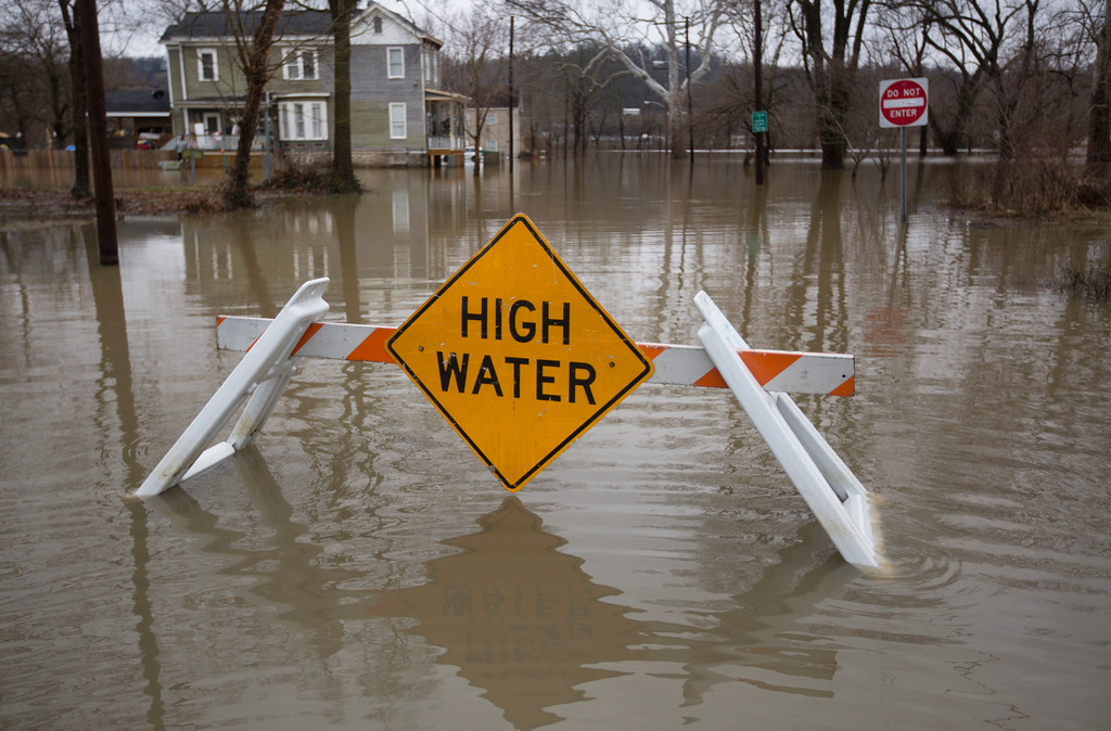 . High water floods the street from the Ohio River, Saturday, Feb. 24, 2018 in Cincinnati.  Forecasters expected the Ohio River could reach levels not seen since the region\'s deadly 1997 floods.(Liz Dufour/The Cincinnati Enquirer via AP)