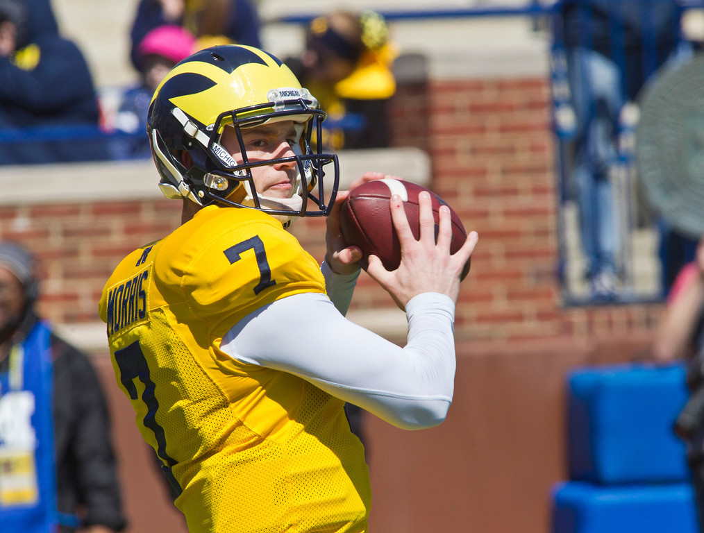 . Michigan quarterback Shane Morris (7) practices throwing passes during the football team\'s annual spring game, Saturday, April 5, 2014, in Ann Arbor, Mich. (AP Photo/Tony Ding)