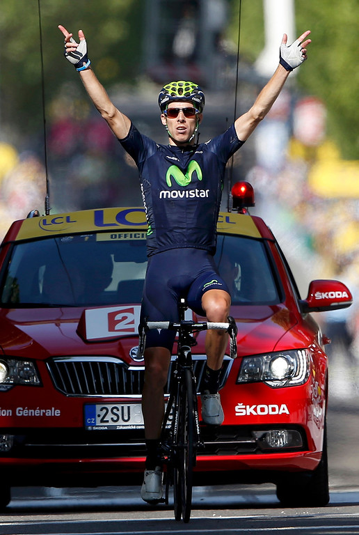 . Movistar Team rider Rui Alberto Costa of Portugal crosses the finish line to win the 168 km sixteenth stage of the centenary Tour de France cycling race from Vaison-La-Romaine to Gap July 16, 2013.    REUTERS/Eric Gaillard