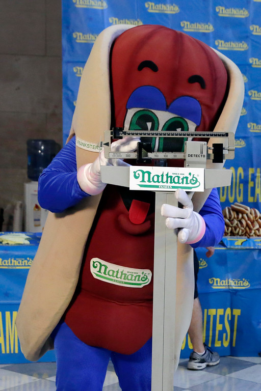 . The Nathan\'s character poses for photos on the scale during the weigh-in for the 2017 Nathan\'s Hot Dog Eating Contest, in Brooklyn Borough Hall, in New York, Monday, July 3, 2017. (AP Photo/Richard Drew)