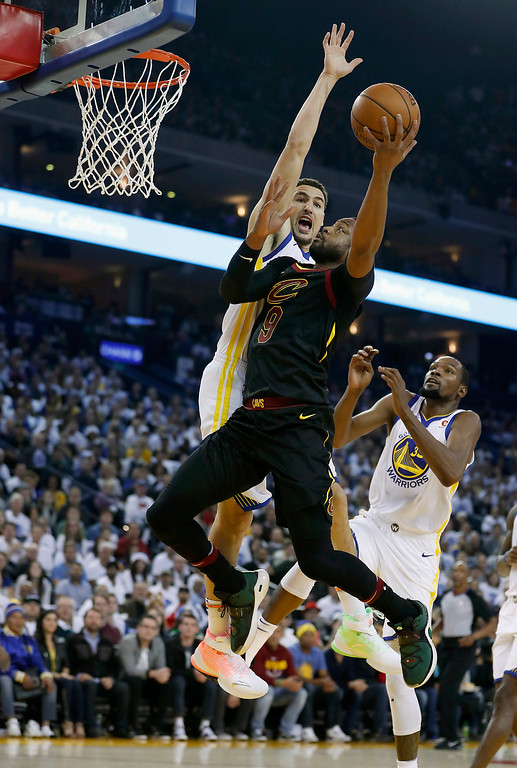 . Cleveland Cavaliers guard Dwyane Wade (9) drives to the basket against Golden State Warriors guard Klay Thompson (11) during the first half of an NBA basketball game in Oakland, Calif., Monday, Dec. 25, 2017. (AP Photo/Tony Avelar)
