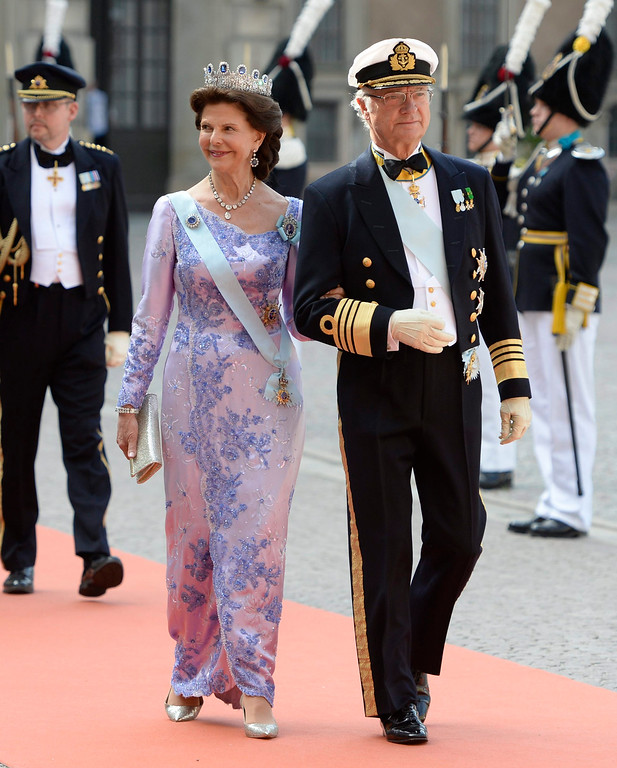. Sweden\'s King Carl Gustaf, right, and Queen Silvia  for the wedding of  their son, Prince Carl Philip and Sofia Hellqvis, , in Stockholm, Sweden, Saturday, June 13, 2015.  The only son of King Carl XVI Gustaf and Queen Silvia has married his Swedish fiancee in a lavish ceremony in Stockholm. Prince Carl Philip and the former reality starlet and model Sofia Hellqvist, 30, tied the knot Saturday at the Royal Palace chapel before five European queens, a Japanese princess and dozens of other blue-blooded guests.  (Jessica Gow/ TT via AP)