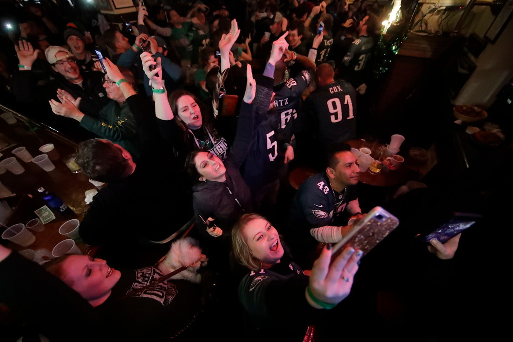 . People react during NFL Super Bowl 52 between the Philadelphia Eagles and the New England Patriots, Sunday, Feb. 4, 2018, in Philadelphia. (AP Photo/Matt Rourke)