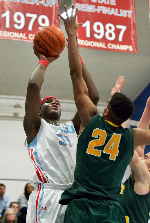 . Jeff Forman/JForman@News-Herald.com Carlton Bragg, VASJ, shoots as Malik Smith, St. Edward, defends in the second quarter of the Vikings\' 82-76 loss Feb. 20 at Villa Angela -St. Joseph High School.