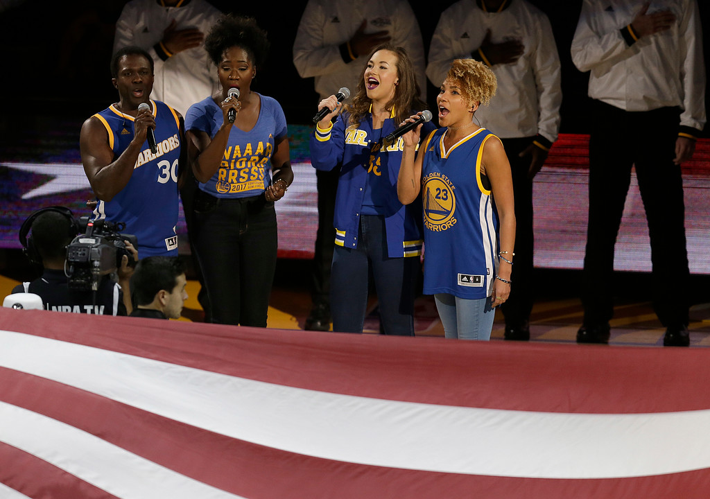 ". Broadway musical ""Hamilton\"" cast members Joshua Henry, from left, Amber Iman, Solea Pfeiffer and Emmy Raver-Lampman perform the national anthem before Game 5 of basketball\'s NBA Finals between the Golden State Warriors and the Cleveland Cavaliers in Oakland, Calif., Monday, June 12, 2017. (AP Photo/Ben Margot)"