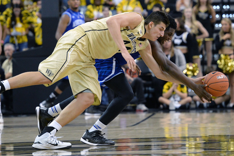 Dinos Mitoglou fights for loose ball.jpg