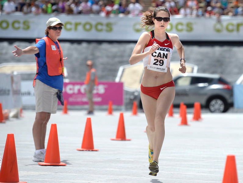 . Team Canada\'s Sabrina Shirley Wilkie runs towards the finish line in the women\'s elite race during the Bolder Boulder on Monday, May 27, in Boulder.  Jeremy Papasso/ Camera