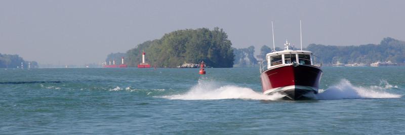 Bumboat leaving Livingston Channel