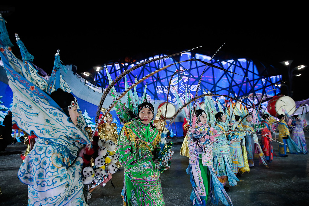 . BEIJING, CHINA - DECEMBER 31:  Chinese folk artists dressed in costume drama performances during the New Year\'s Eve count down to 2015 during a New Year\'s eve countdown event to promote the city\'s 2022 Winter Olympic bid at Olympic Park on December 31, 2014 in Beijing, China.  (Photo by Lintao Zhang/Getty Images)