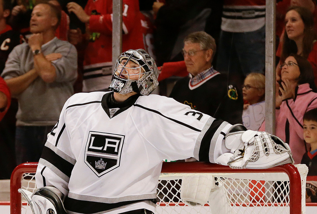 . Los Angeles Kings goalie Jonathan Quick looks up at the scoreboard after a goal by the Chicago Blackhawks in the second period of Game 1 of the NHL hockey Stanley Cup Western Conference finals, Saturday, June 1, 2013, in Chicago. (AP Photo/Nam Y. Huh)