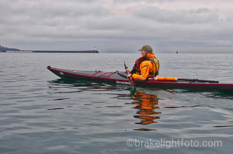 Kayaking past Ogden Point Breakwater
