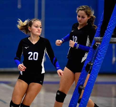 9/18/2019 Mike Orazzi | StaffrBristol Eastern Girls Volleyball's Lucy Winiarski (20) and Leah Chipman (18) during Wednesday night's match with Plainville. r