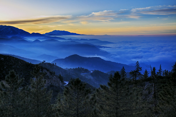 Mountains tucked with fog and clouds- sunrise makes it even more spectacular