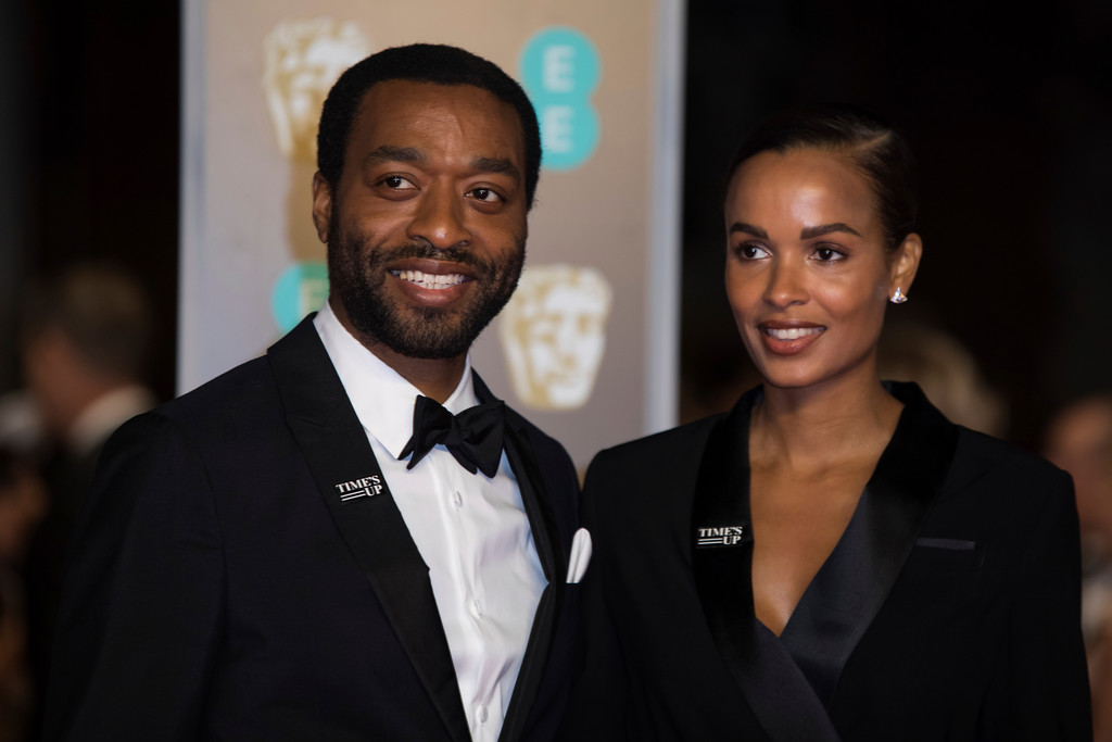 . Chiwetel Ejiofor and Frances Aaternir pose for photographers upon arrival at the BAFTA Awards 2018 in London, Sunday, Feb. 18, 2018. (Photo by Vianney Le Caer/Invision/AP)