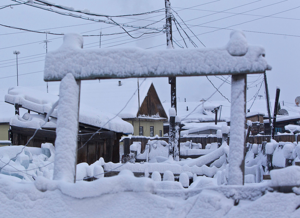 . A view of snow-covered houses in the village of Tomtor in the Oymyakon valley, in the Republic of Sakha, northeast Russia, January 24, 2013. The coldest temperatures in the northern hemisphere have been recorded in Sakha, the location of the Oymyakon valley, where according to the United Kingdom Met Office a temperature of -67.8 degrees Celsius (-90 degrees Fahrenheit) was registered in 1933 - the coldest on record in the northern hemisphere since the beginning of the 20th century. Yet despite the harsh climate, people live in the valley, and the area is equipped with schools, a post office, a bank, and even an airport runway (albeit open only in the summer).  Picture taken January 24, 2013.    REUTERS/Maxim Shemetov