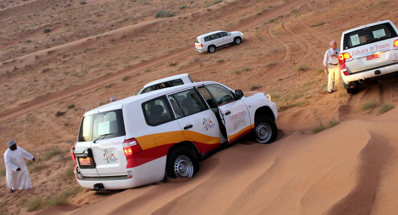 Four-wheel drive vehicle stuck in the sand dunes near Desert Nights Camp, Oman – Josef Rokus