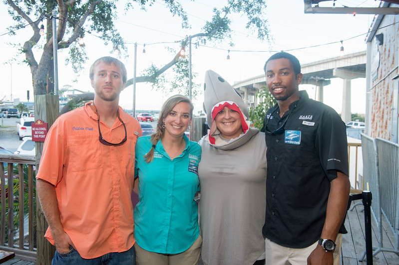 Chad Banks (left), Kesley Gibson, Ashley Ferguson, and David Norris enjoy the event at Brewster Street Ice House.