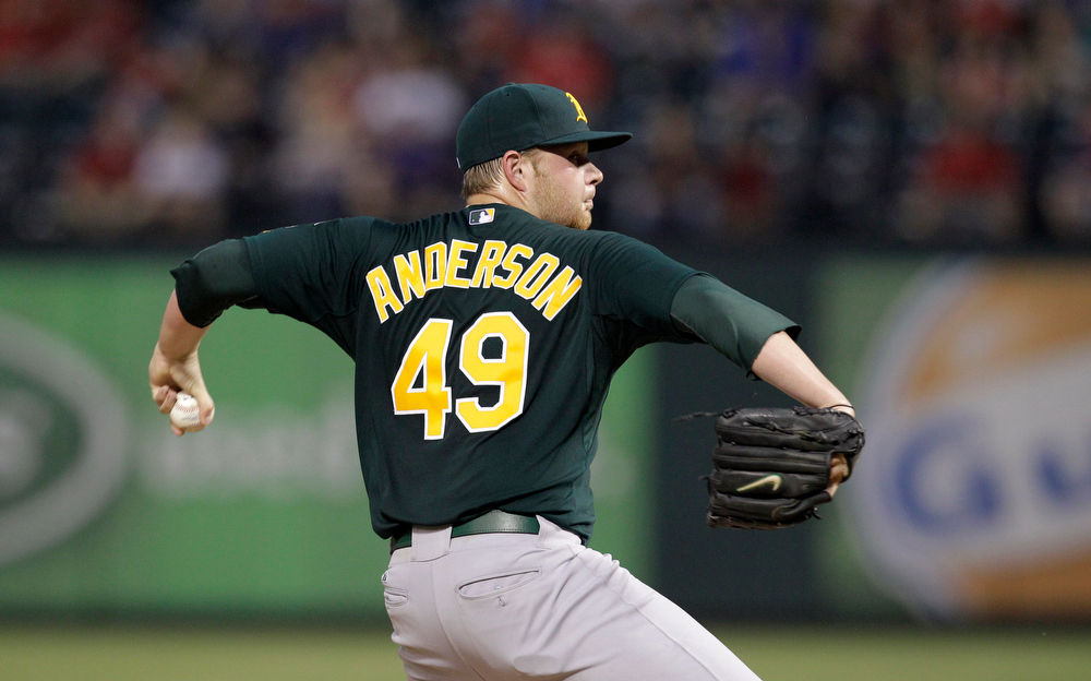 . Oakland Athletics\' Brett Anderson (49) delivers to the Texas Rangers in the fourth inning of a baseball game Tuesday, May 10, 2011, in Arlington, Texas. (AP Photo/Tony Gutierrez)