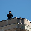 Rooftop security. 2009 Remembrance Day Ceremony in Ottawa, Ontario.<br /> <br /> © Rob Huntley