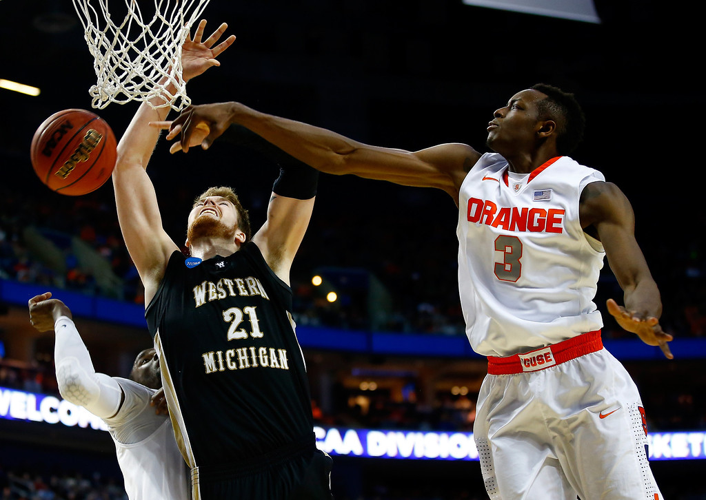 . BUFFALO, NY - MARCH 20:  Jerami Grant #3 of the Syracuse Orange blocks a shot by Shayne Whittington #21 of the Western Michigan Broncos during the second round of the 2014 NCAA Men\'s Basketball Tournament at the First Niagara Center on March 20, 2014 in Buffalo, New York.  (Photo by Jared Wickerham/Getty Images)