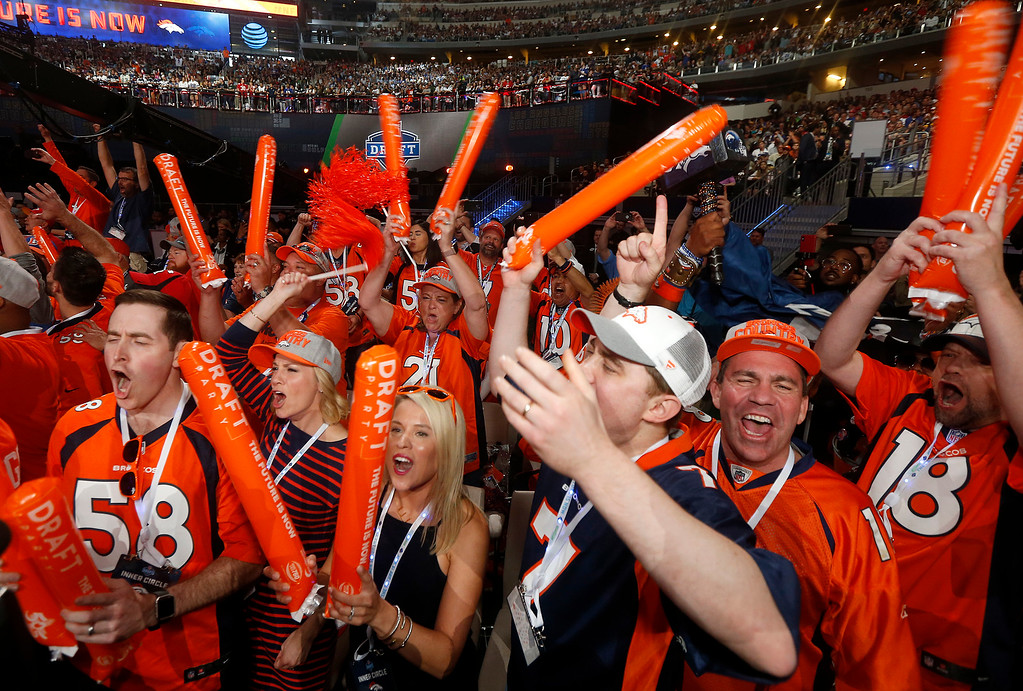 . Denver Broncos fans celebrate the selection of North Carolina State\'s Bradley Chubb during the first round of the NFL football draft, Thursday, April 26, 2018, in Arlington, Texas. (AP Photo/Michael Ainsworth)
