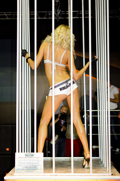 Cage dancing girl at Igromir 2011