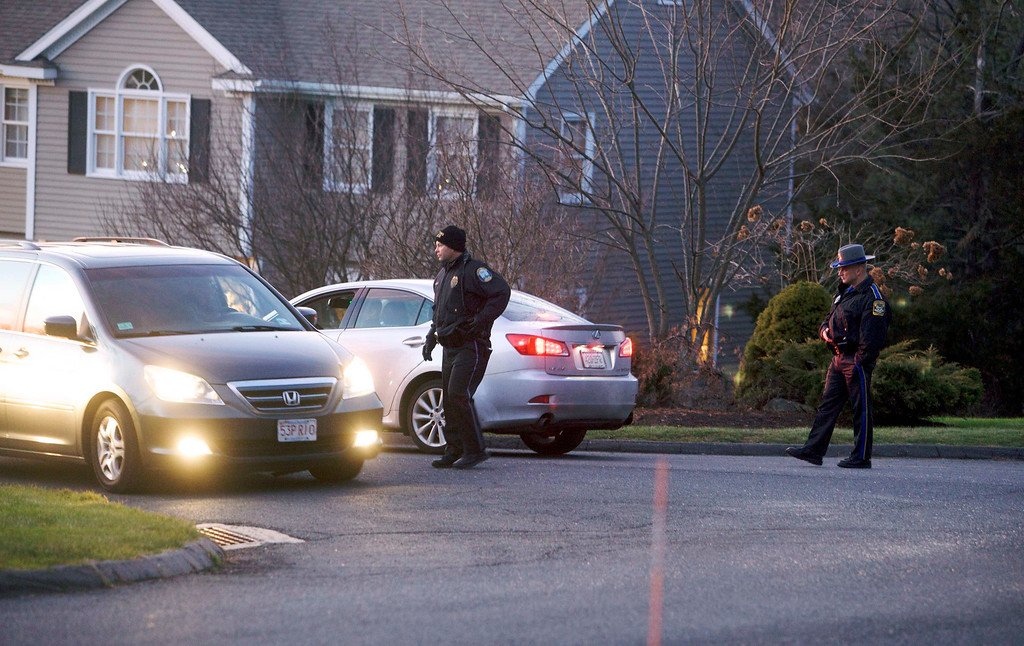 . Police block streets near the secondary crime scene following a shooting at Sandy Hook Elementary School, in Sandy Hook, Connecticut, December 14, 2012. The peace and security of the suburban Connecticut community of Newtown lay shattered on Friday after a gunman attacked a primary school in one of the worst mass shootings in U.S. History. Tearful parents and children gathered around Sandy Hook Elementary School by midday on Friday, surrounded by police vehicles, as young and old alike struggled to make sense of a shooting rampage that killed at least 28 people, including 20 children. REUTERS/Michelle McLoughlin