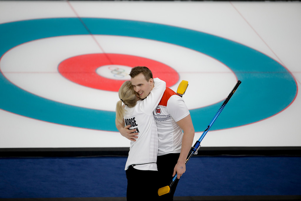 . Norway\'s Kristin Skaslien, left, and Magnus Nedregotten embrace each other after winning a mixed doubles curling match against China\'s Wang Rui and Ba Dexin at the 2018 Winter Olympics in Gangneung, South Korea, Sunday, Feb. 11, 2018. (AP Photo/Natacha Pisarenko)