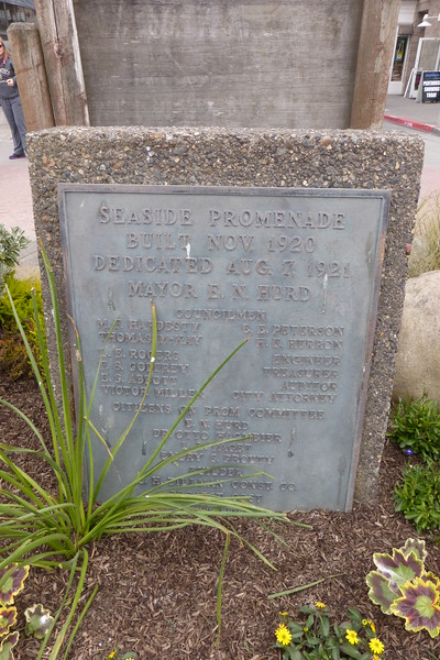 The plaque under the statue