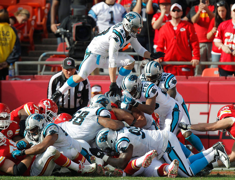. Carolina Panthers free safety Haruki Nakamura (43) jumps over the pile during a goal line stance in the first half of an NFL football game against the Kansas City Chiefs at Arrowhead Stadium in Kansas City, Mo., Sunday, Dec. 2, 2012. (AP Photo/Ed Zurga)